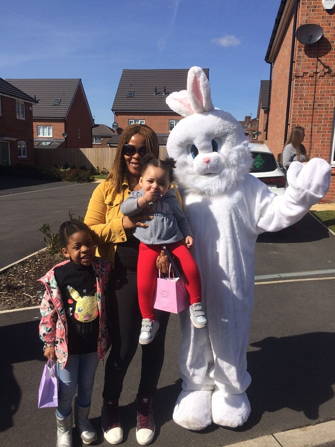 Family pose with giant Easter bunny