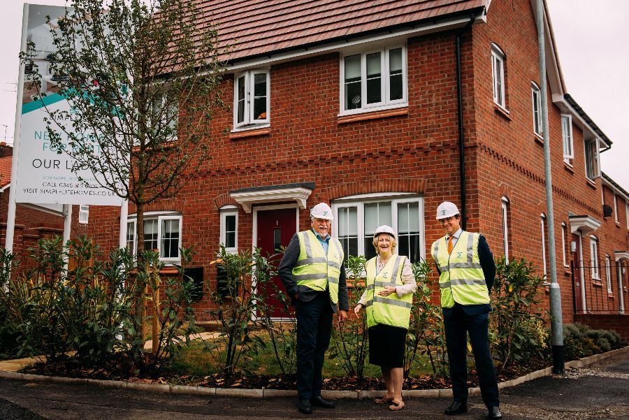 MP Mary Robinson and Simple Life directors pose outside family house in Hi-vis vests